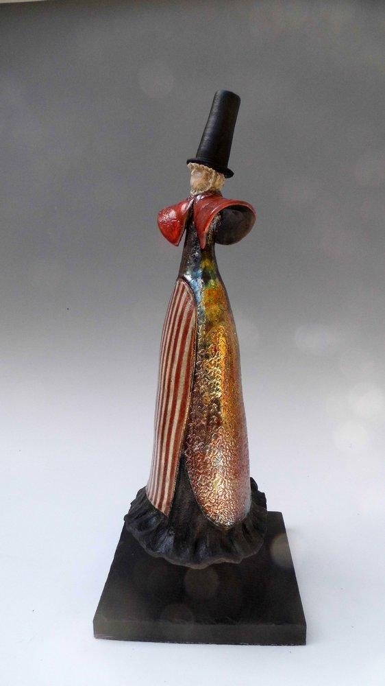 Raku Welsh lady gold skirt
