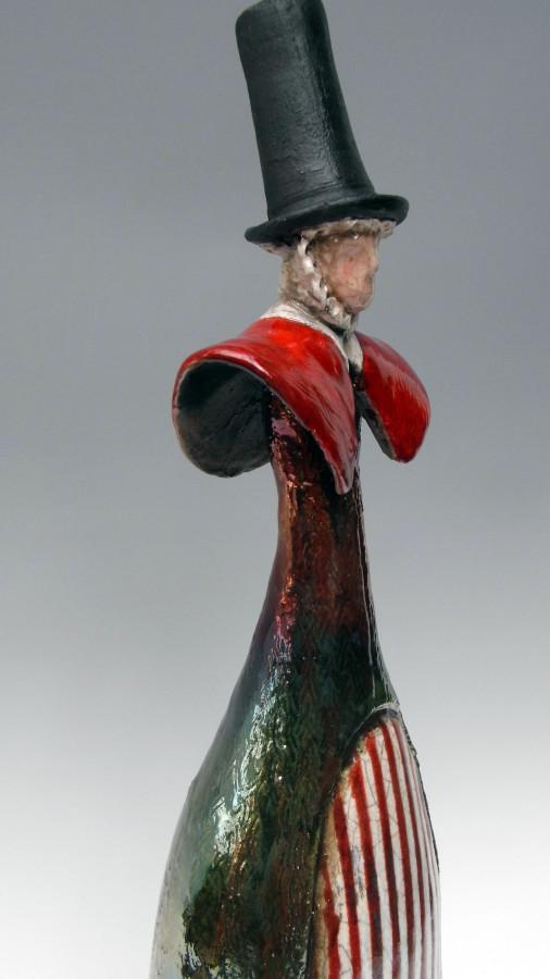 Raku welsh lady red stripe apron iridescent skirt close up