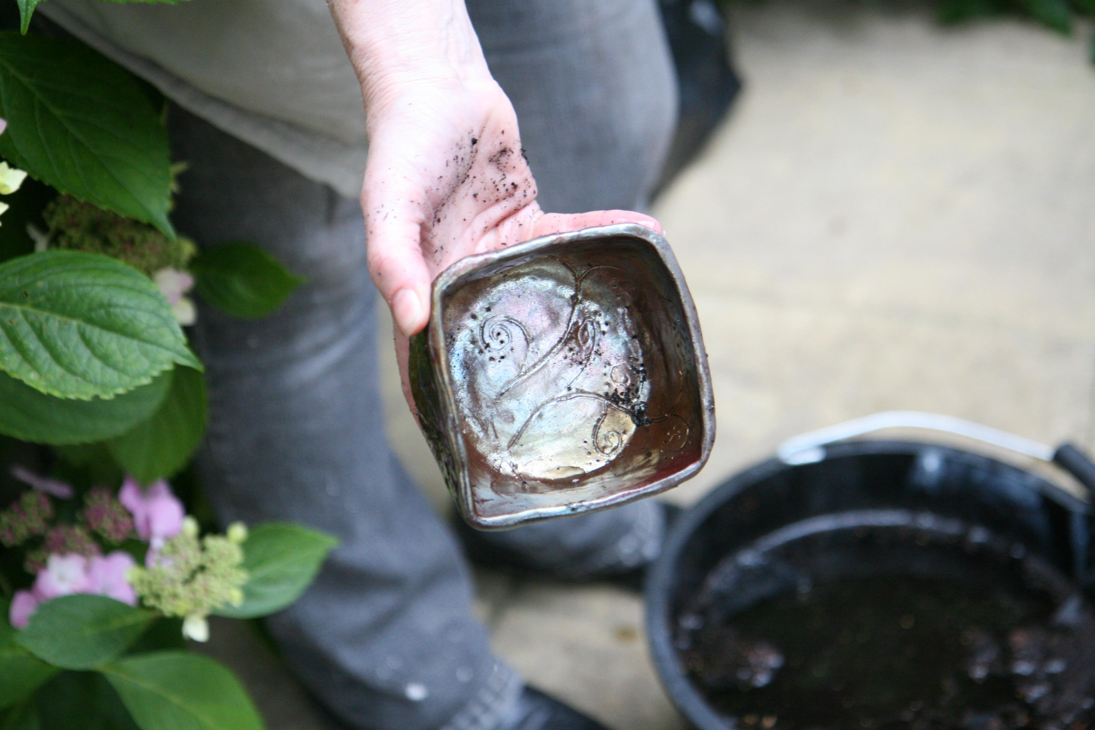Raku Firing - copper fired pot ready for cleaning