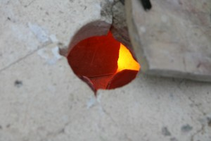 Raku Firing - Checking the glaze is molten close up