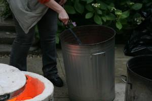Raku Firing - placing pot in reduction chamber