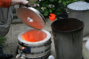 Raku Firing - removing pot when glowing hot